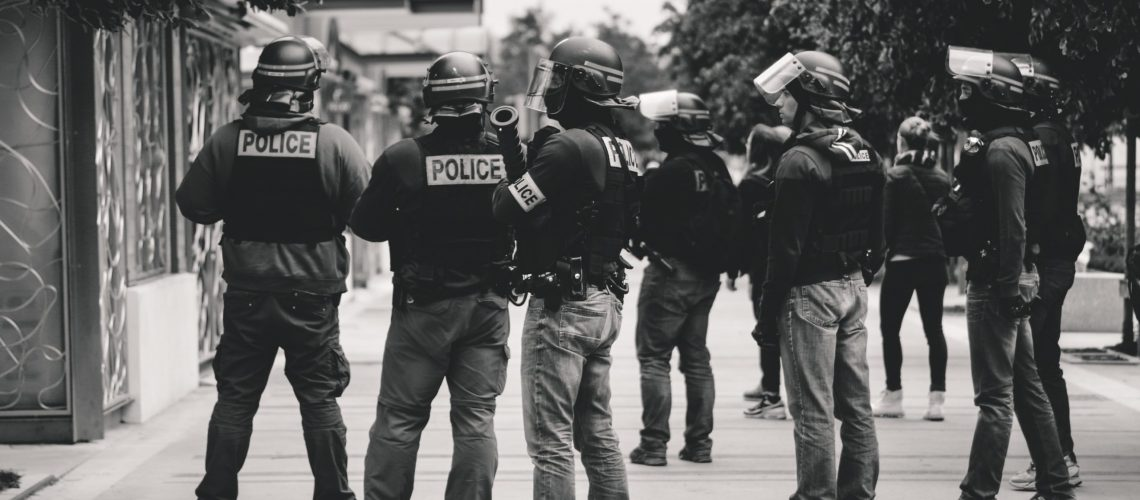grayscale photo of police officers